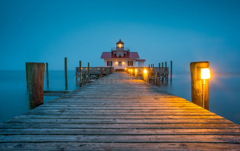 Manteo NC Roanoke Marshes Lighthouse Outer Banks North Carolina. Manteo NC Roanoke Marshes Lighthouse at Outer Banks North Carolina public park in heavy fog on stock photo