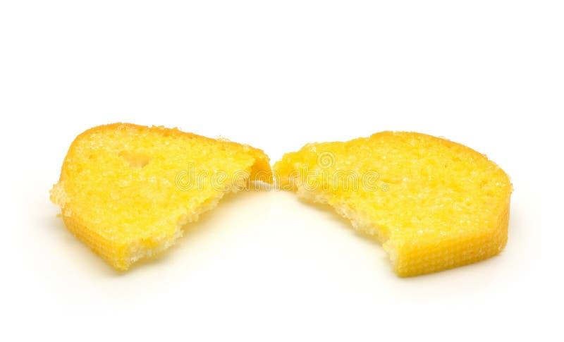 Mantequilla curruscante del pan con el azúcar en blanco fotografía de archivo