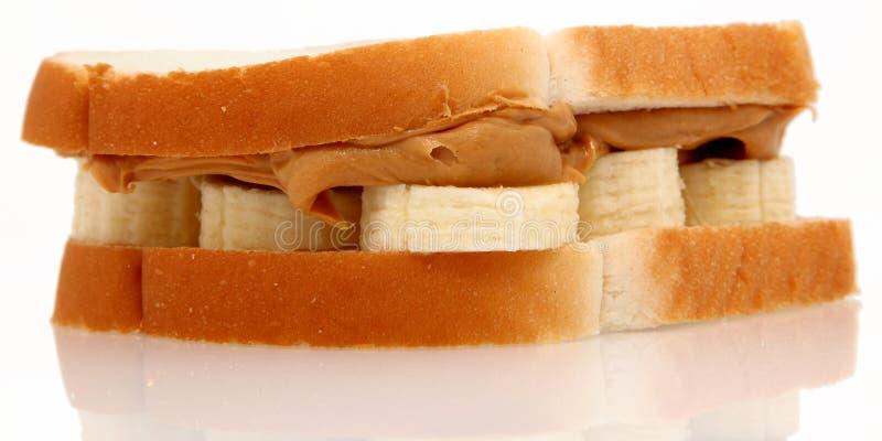 Mantequilla de cacahuete y emparedado del plátano fotografía de archivo libre de regalías