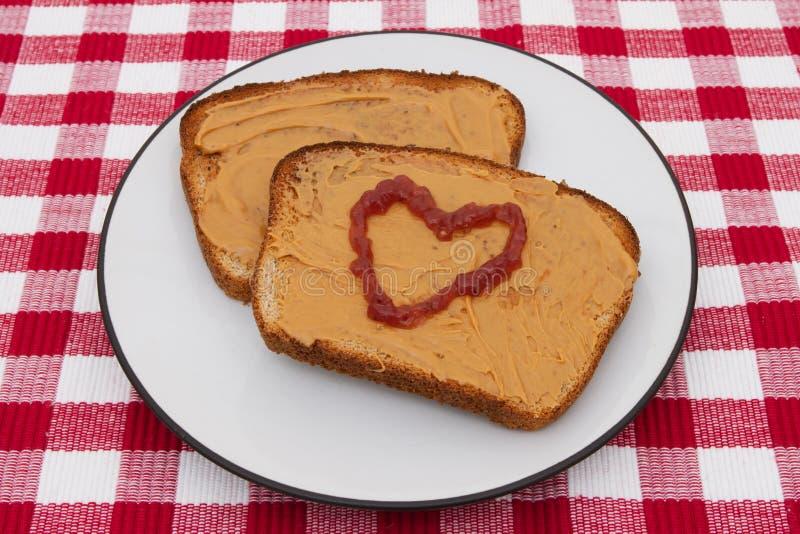 Mantequilla y atasco de cacahuete del amor fotografía de archivo libre de regalías