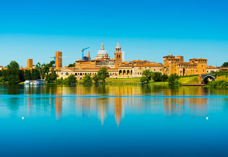 Mantova, Italy: Cityscape reflected in water. Old Italian town skyline. Province of Lombardy stock photo