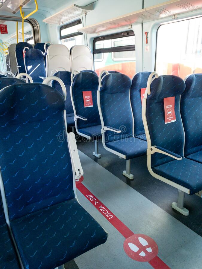 Mantova, Italy - 20th June 2020: trenitalia train with red signs on the seats that say to leave seat free. New distancing rules due to coronavirus pandemic royalty free stock photo