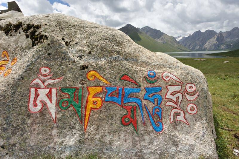 Mantra die in Tibetan manuscript wordt geschreven royalty-vrije stock fotografie