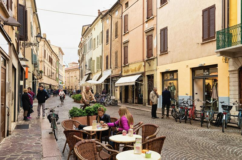 People at street cafe on Via Giuseppe Verdi in Mantua royalty free stock image