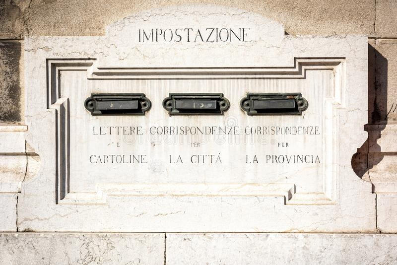 MANTUA: View of a ancient marble mailbox from Le Poste, the Italian public postal service, in the city Mantua. Italy. View of a ancient marble mailbox from Le royalty free stock image