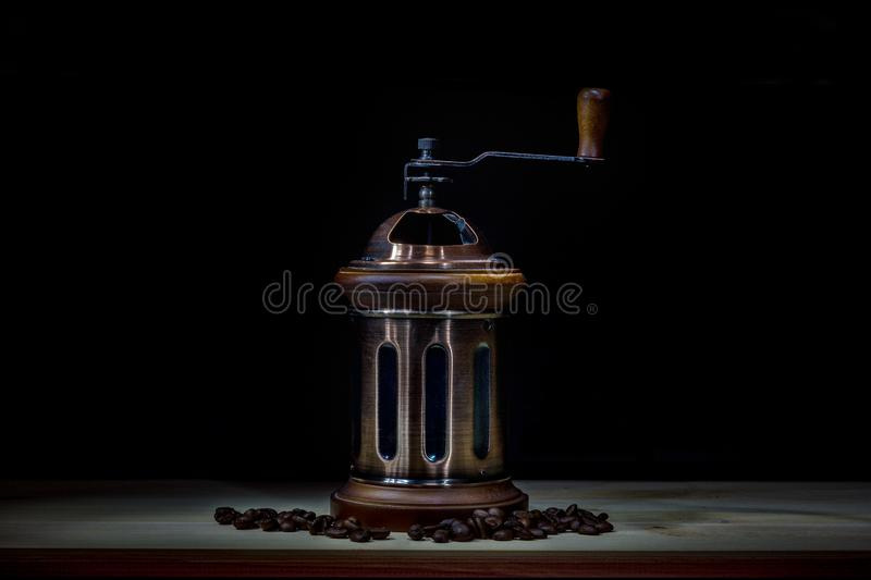 Manual coffee grinder and coffee beans on the table royalty free stock photography
