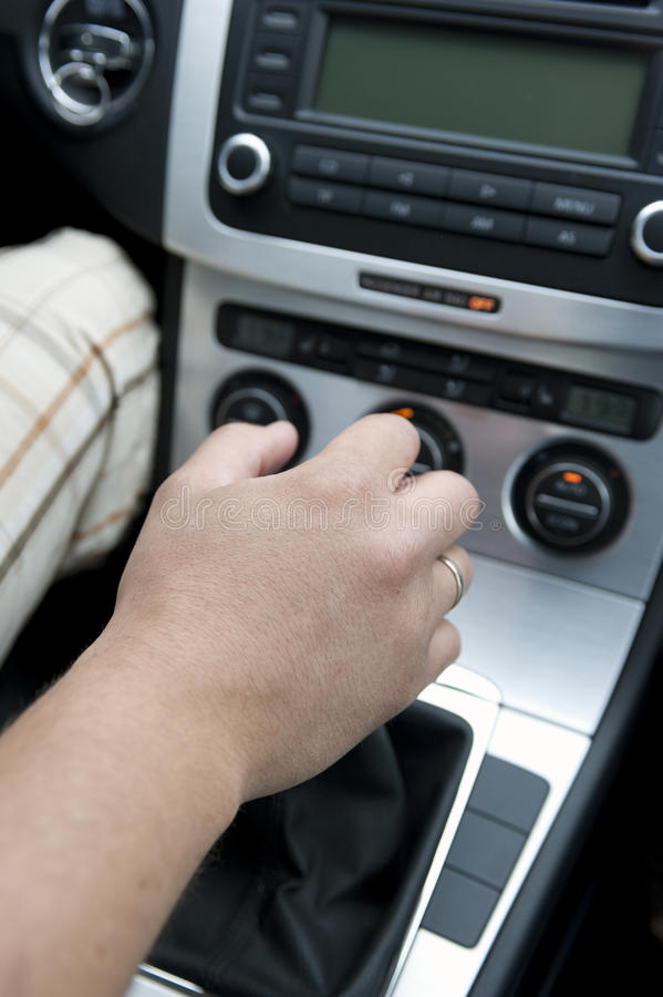 Manual Gear Shift. Close up of hand on manual gear shift knob stock image