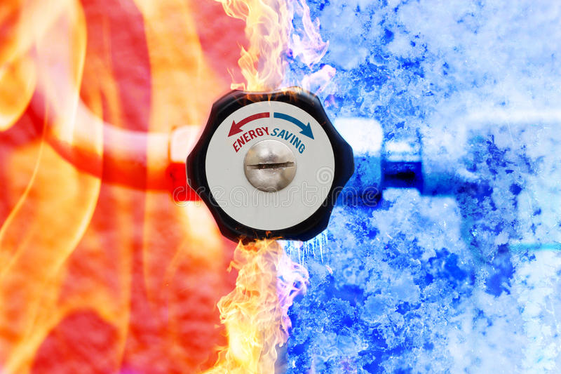 Manual heating controller with red and blue arrows in fire and ice background.  royalty free stock photography