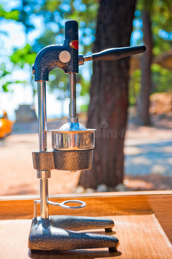 Manual Juicer Chrome. Street restaurant royalty free stock photography