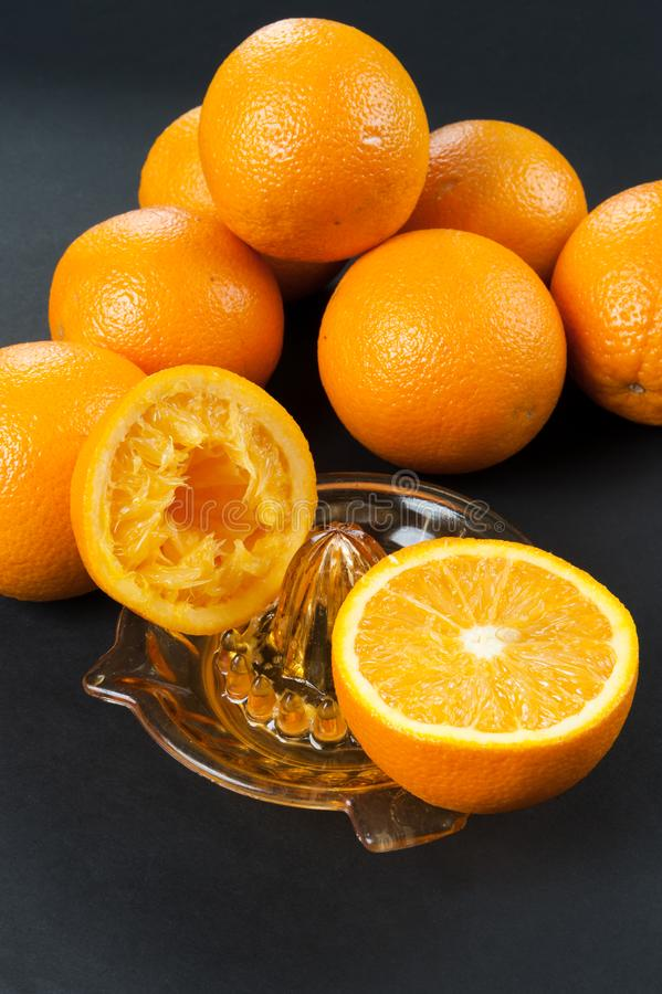 Manual juicer with oranges stock image