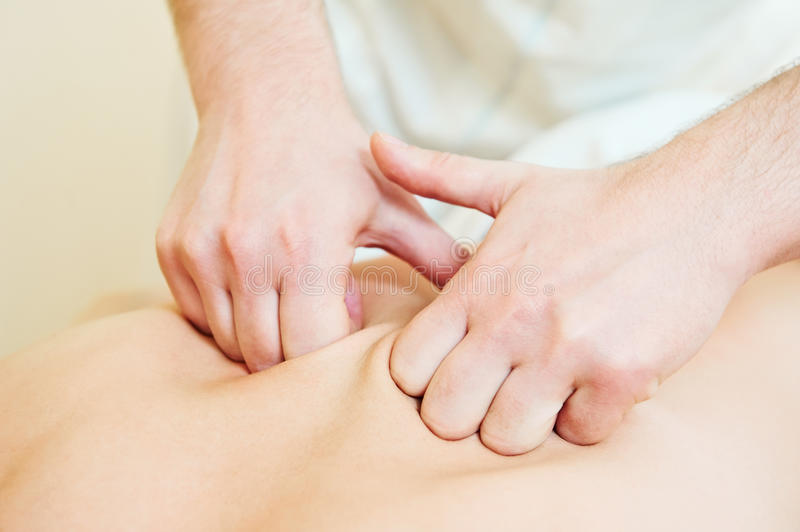 Manual medical massage technique stock photography