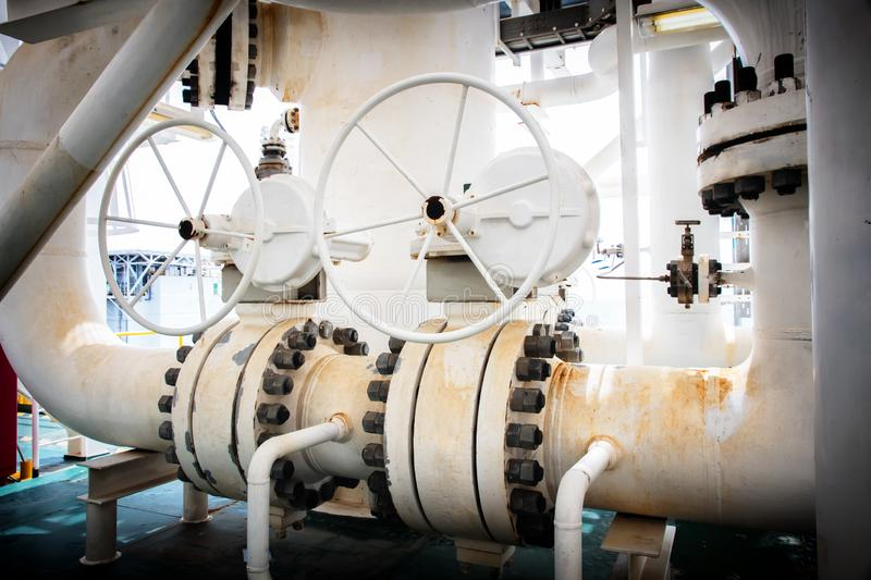 Manual operate ball valve at offshore oil and gas central processing platform, manual valve stock photography