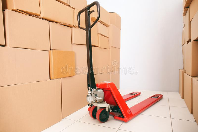 Manual pallet truck with boxes royalty free stock photo