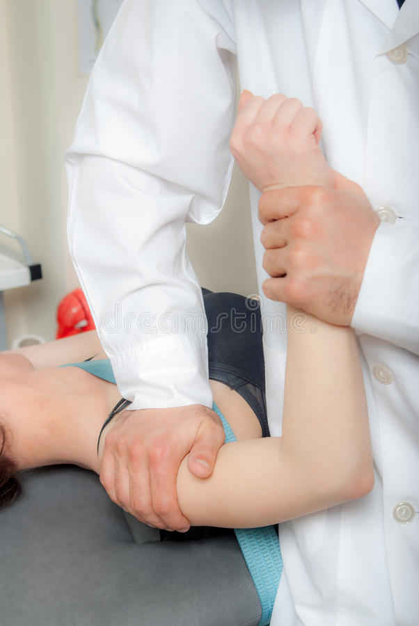 Manual, physio and kinesio therapy techniques performed stock image