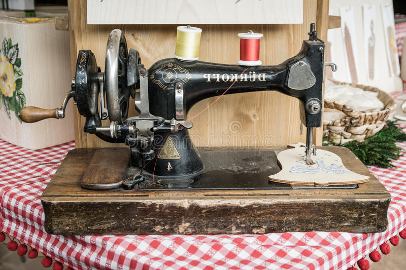 Manual sewing machine used to embroider wooden shapes. Trento, Italy - December 15, 2015: Old manual sewing machine used to embroider wooden shapes stock photos