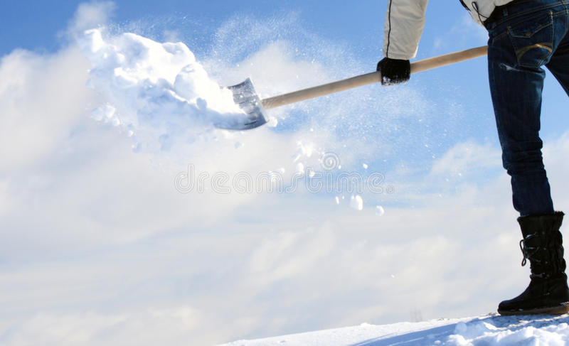 Manual snow removal stock photography