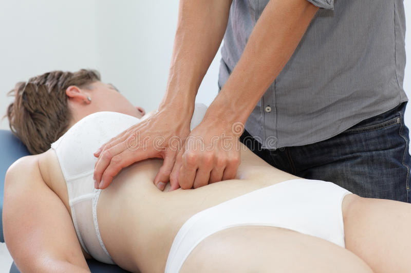 Manual therapy of internal organs in intestinal dysfunction. Osteopathy royalty free stock image