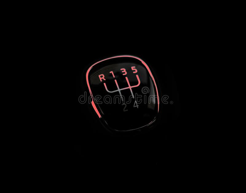 Manual transmission gear shift, on dark backgroun with red light. Close-up royalty free stock photo