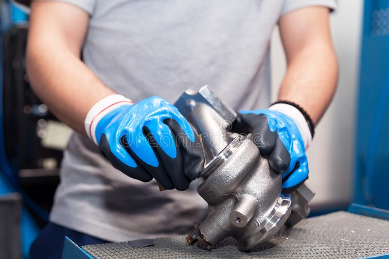 Manual work in production of vehicle part in the automotive industry. Production of car parts in the automotive industry stock photos