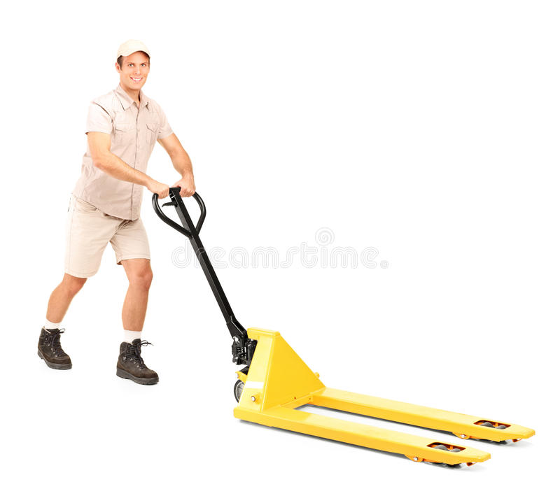 Download Manual Worker And A Fork Pallet Truck Stacker Stock Photo - Image of industry, standing: 21605802
