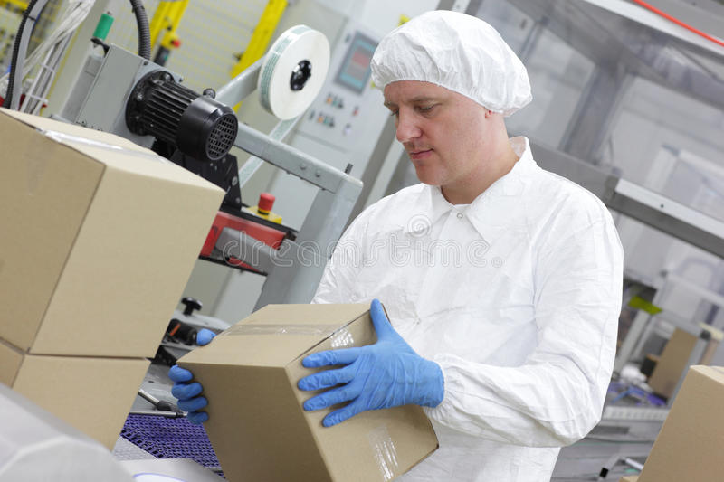 Manual worker at production line dealing with boxe royalty free stock photo