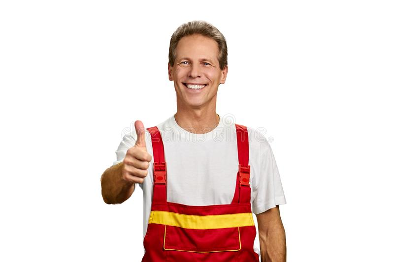 Manual worker showing thumb up sign. royalty free stock image