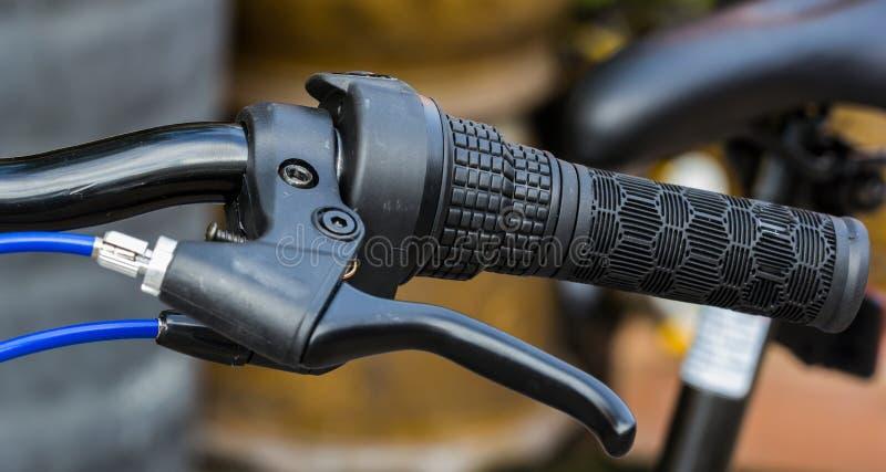 Manubrio e freno della bicicletta fotografia stock libera da diritti