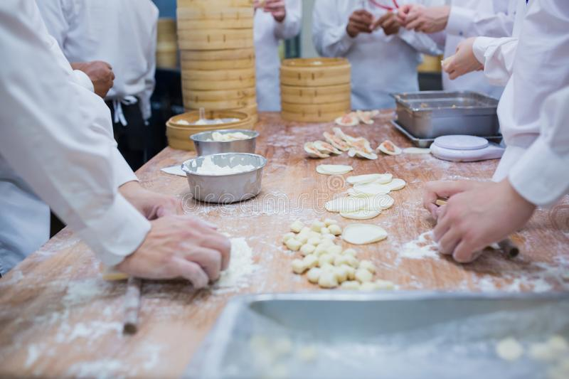 Manufacture of Dim sum. Manufacture of Chinese food by Chinese chefs in restaurant royalty free stock photo