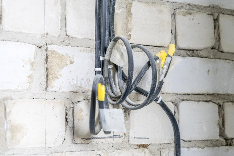 Manufacture of electrical wiring in a brick house stock images