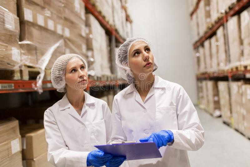 Women technologists at ice cream factory warehouse royalty free stock image