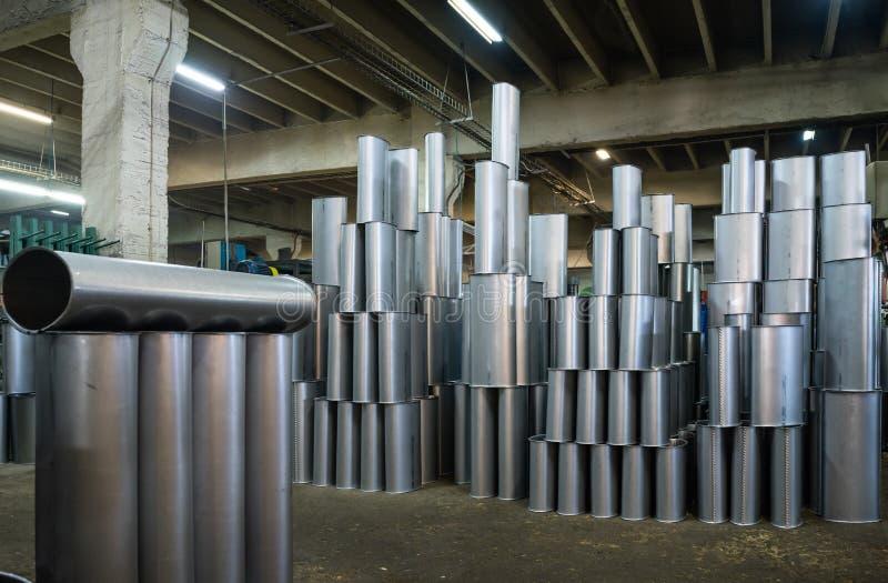 Manufactured silver metallic tubes royalty free stock photo