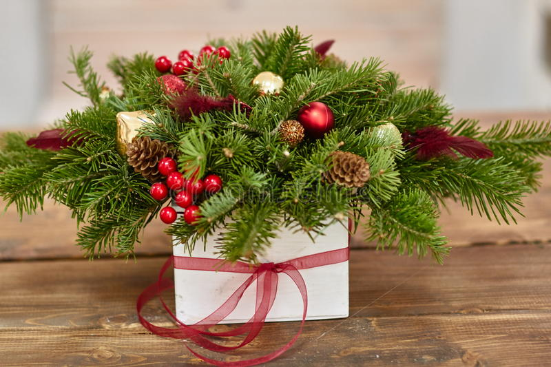 Manufacturer of Christmas decor with their own hands. Christmas box with twigs for the holiday. The new year celebration stock photo