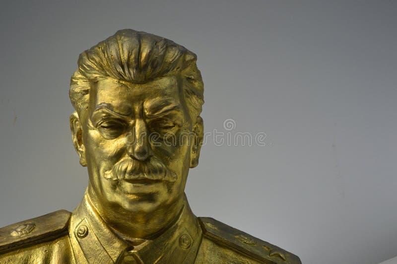 Manufatti comunisti - statua di Stalin dell'oro - museo Praga immagini stock