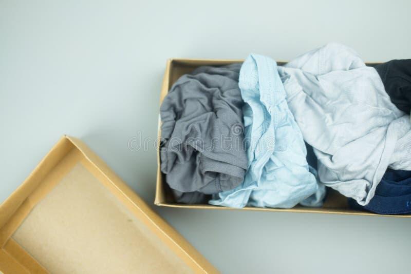 Manunderkläder i brun packe för pappers- ask royaltyfria foton