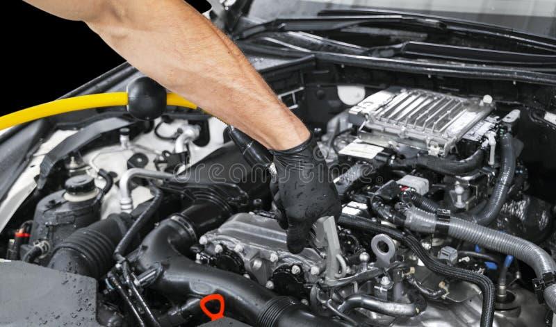 Manutenção de detalhe do carro Motor de limpeza com vapor quente lavagem de alta pressão Lavagem na estação Conceito de lavagem d imagem de stock royalty free
