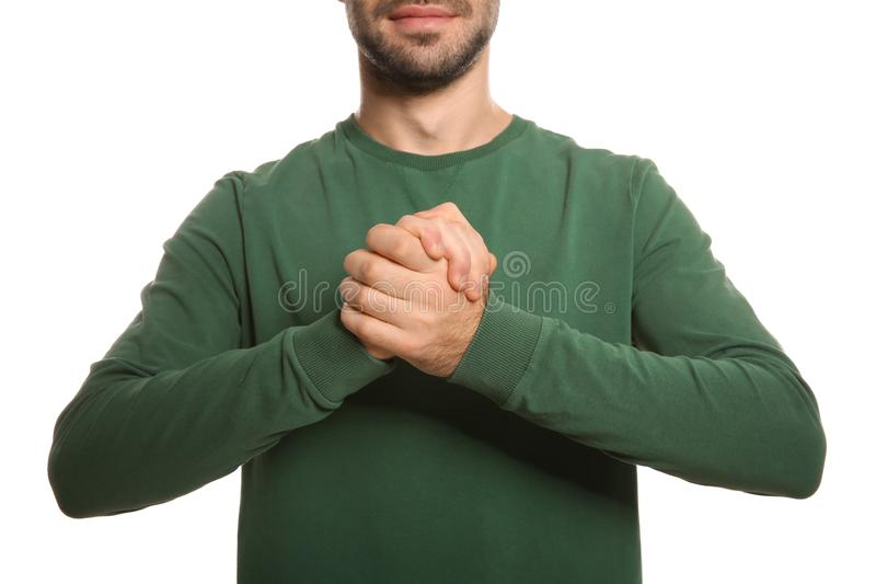 Manvisningen TROR gest i teckenspråk på vit bakgrund arkivbilder