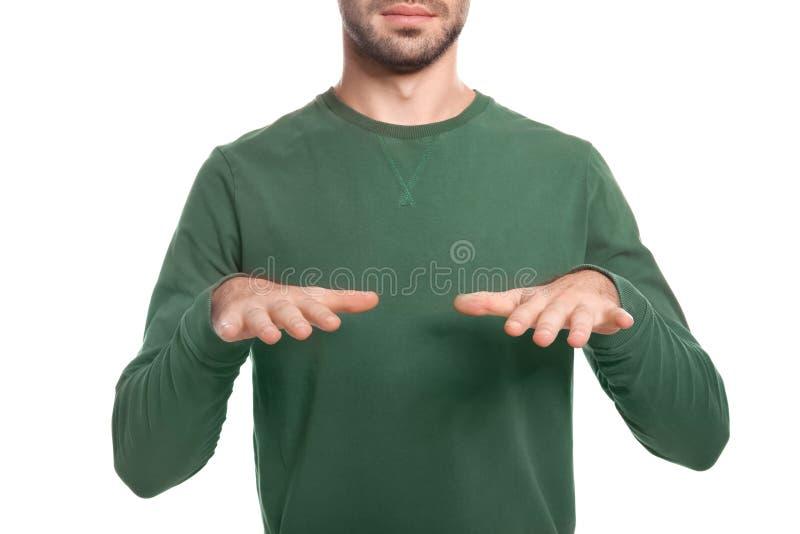 Manvisningen VÄLSIGNAR gest i teckenspråk på vit bakgrund royaltyfri foto