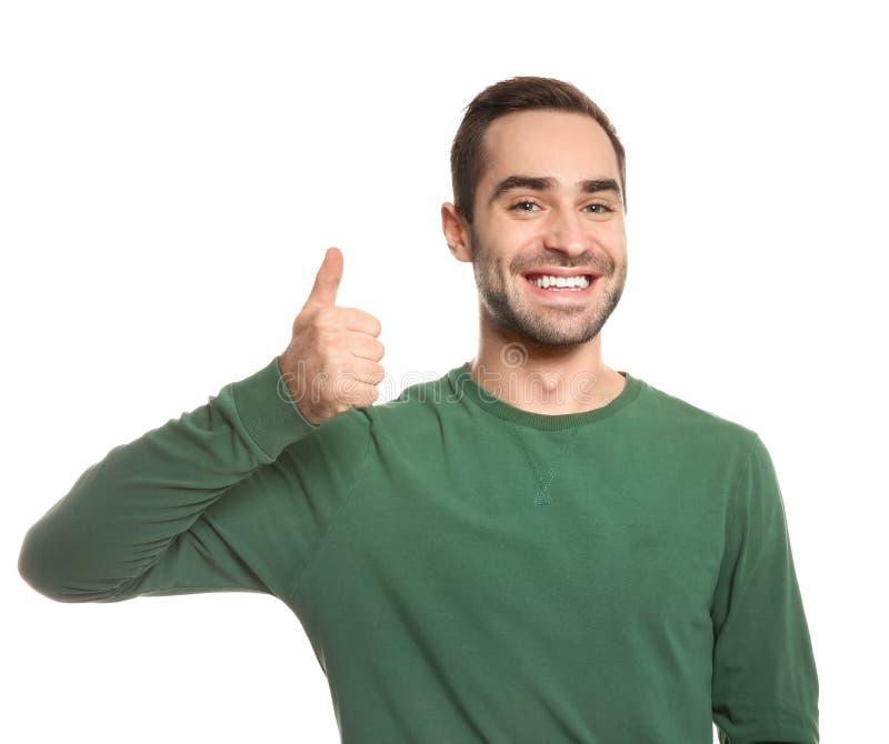 ManvisningTUMME UPP gest i teckenspråk på vit arkivfoto