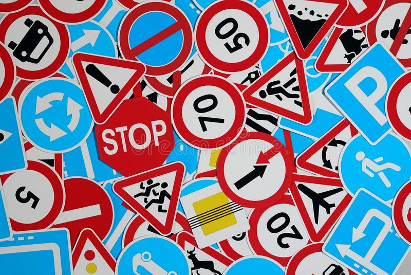 Road signs. Many traffic signs mixed together royalty free stock images