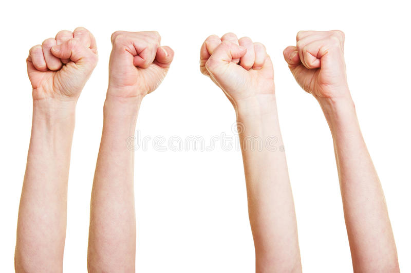 Many angry clenched fists. Reaching into the air royalty free stock image