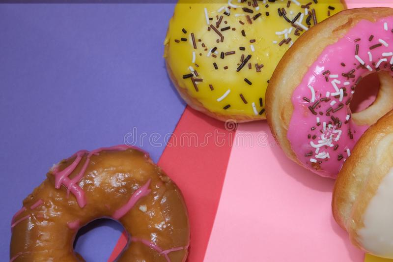 Donuts  on colorful background. Many Assorted donuts on a background stock photos