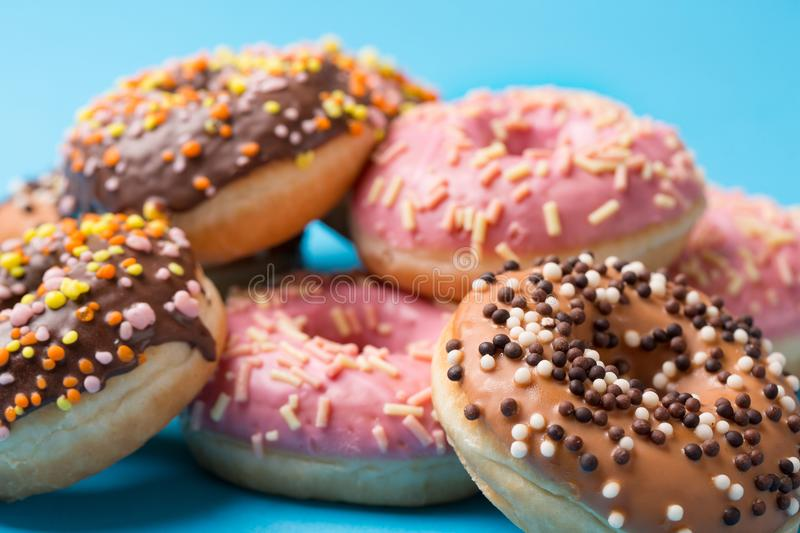 Assorted donuts on a blue background stock photography
