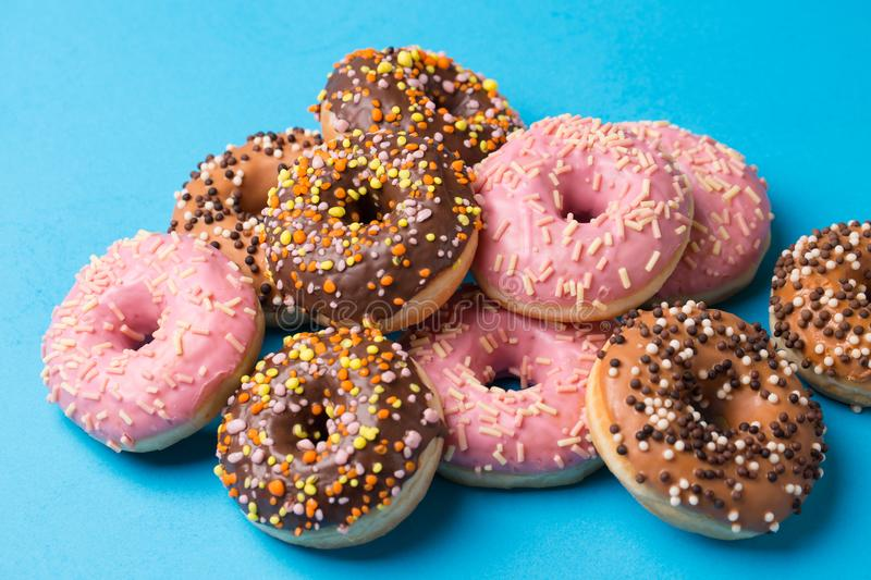 Assorted donuts on a blue background royalty free stock images