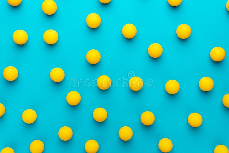 Many balls for table tennis on turquoise blue background royalty free stock photography