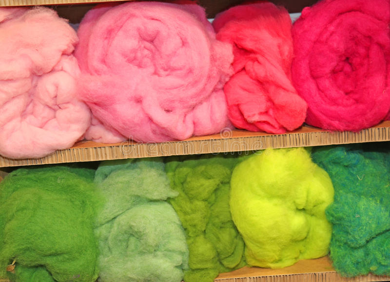 So many balls of wool very soft and voluminous. For sale in the. Balls of wool very soft and voluminous. For sale in the wholesaler's shop stock image