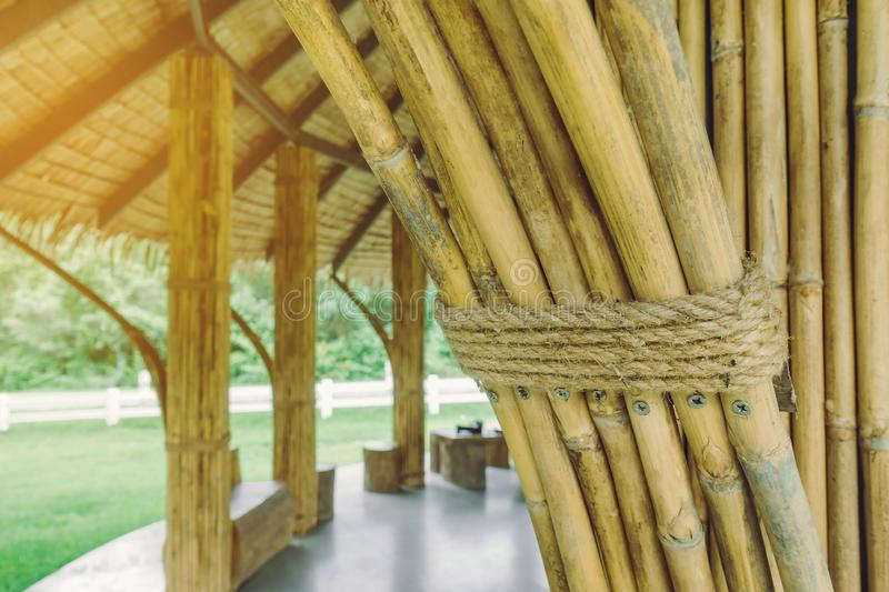 Many bamboo bindings are tied together with hemp ropes to be used as pole for resting cottage. stock images
