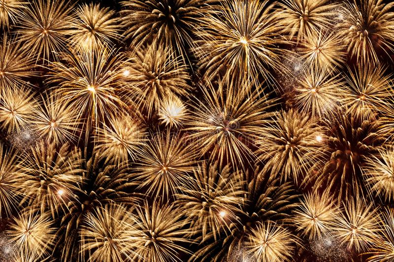 Many beautiful Golden fireworks exploding in the night sky royalty free stock photography