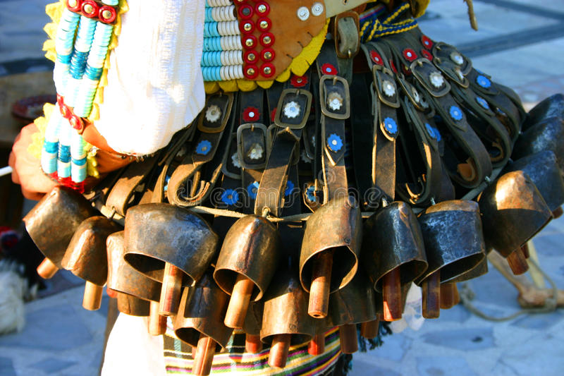 Many bells decorate the costume. Of the dancer royalty free stock photo
