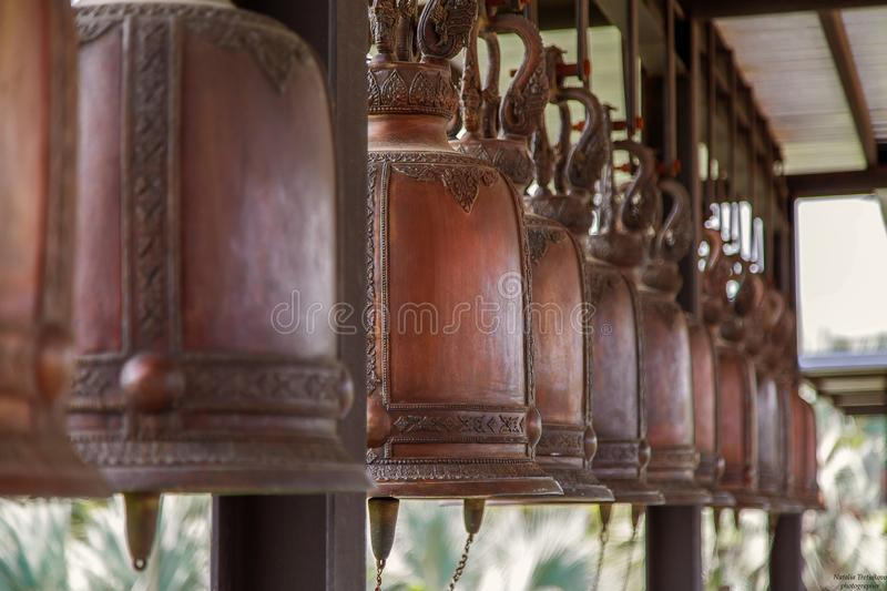 Many bells hang in the temple of Thailand stock image