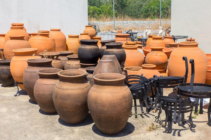 Many big clay vases outside at pottery shop. Many large orange clay vases outdoors at pottery shop in Portugal stock image